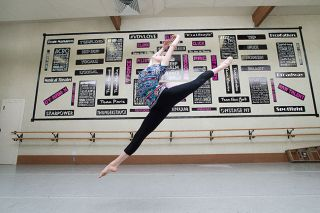 Marcus Larson/News-Register##Mia Audova leaps during practice in the Van de Veere dance rehearsal room at Gallery Theater.  Kathleen Van de Veere was her first teacher. This fall, Mia will start an intensive dance program in Philadelphia.