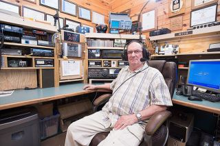 "Marcus Larson/News-Register##Armand Pilotte of Sheridan, the president of the McMinnville Amateur Radio Club, sits in his ""radio shack"" set up in his garage. The Navy vet became fascinated with ham radio when he was a teen-ager growing up in New Hampshire."
