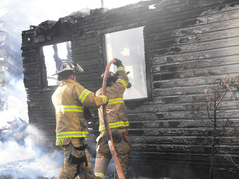 Submitted photo##Firefighters combat a blaze at an abandoned house in Grande Ronde.