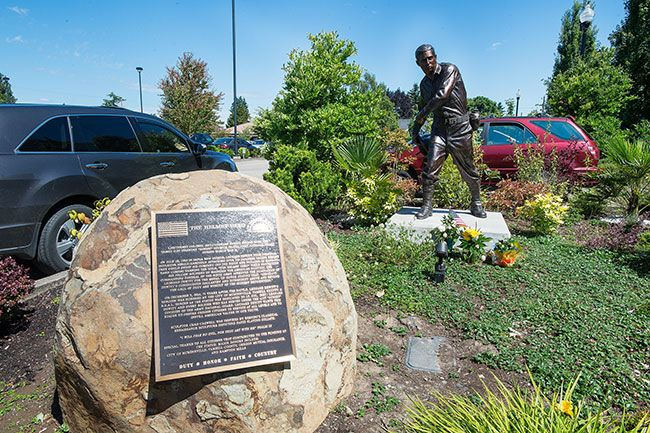Marcus Larson/News-Register##A bronze statue honors Medal of Honor nominee Leonard DeWitt of McMinnville.