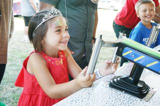 News-Register file photo##Four-year-old Norah Guardiola of Willamina awaits her prize after winning a carnival game during last year's Sheridan Days celebration.