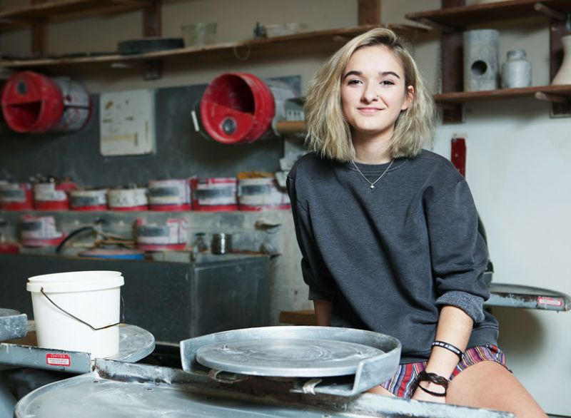 Rockne Roll/News-Register##Mya Clover-Owens sits at the pottery wheel in the McMinnville High School art room. She fell in love with ceramics and other forms of art at Mac High and won a national competition with one of her vases.