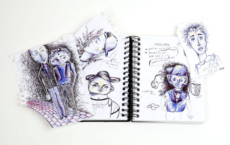 "Rockne Roll/News-Register##Clover-Owens' sketchbook. She enjoys creating characters, ""lots of weird little men,"" she said."