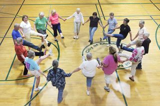 Rockne Roll/News-Register##Hilda Farris' exercise class perform leg kicks as part of a dance routine at the McMinnvile Community Center.