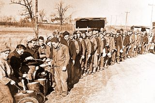 Submitted photos##Men stand and wait in a field serving line during a day's work in the Civilian Conservation Corps near Carlinville, Ill. The CCC provided unemployed young men with $30 per month with food, shelter, and medical care during the Depression.