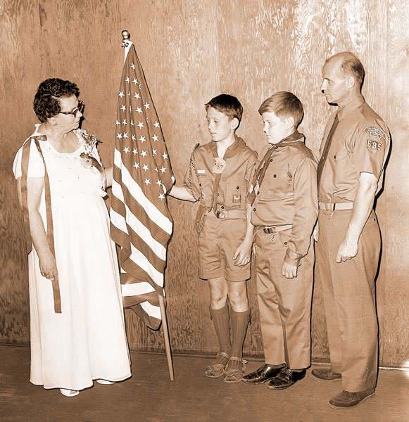##Mrs. Dee Redford, Women's Relief Corps Department of Oregon, presents an American flag to representatives of Boy Scout Troop 695, McMinnville's newest troop. With Scoutmaster Sam Soper were Scouts Loren Soper and Edward Hoem. The presentation was made during the WRC's state convention at Linfield College.