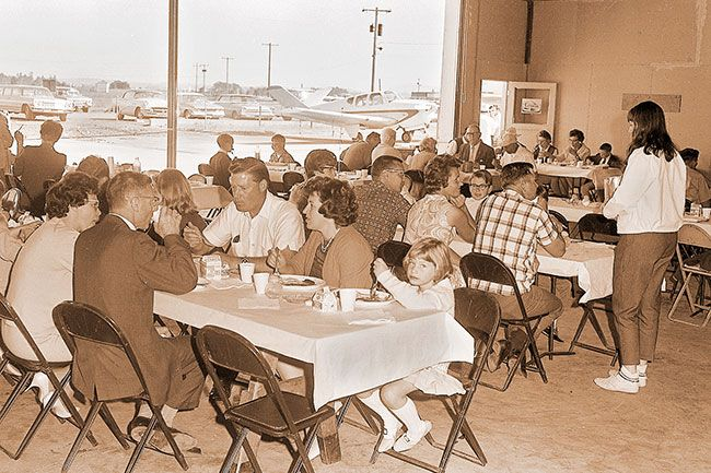 ##(June 7, 1967) Some 350 people attended the Lions Club Fly-In Breakfast and Brunch held at the McMinnville airport Sunday. A special feature of the morning was a community worship service held in a hangar at which time Lions scholarships were presented.
