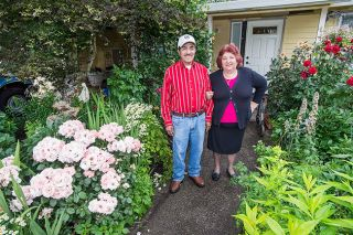 Marcus Larson/News-Register##Jose and Lupe Elias have filled their yard at 600 N.E. Beary St., McMinnville, with a profusion of flowers. The striking results were recognized this month by the McMinnville Garden Club.
