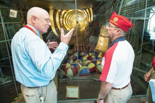 Marcus Larson/News-Register##Evergreen Aviation Museum Director Larry Wood gives American Legion National Commander Mike Helm a personal tour of the museum's featured attraction, the Spruce Goose.