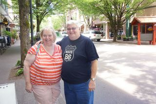 Starla Pointer/News-Register##Judy Wilson-Ester and her husband, Michael, enjoy a walk down Third Street in McMinnville. A native of the Tennessee city of the same name, Wilson-Ester had always wanted to visit here.