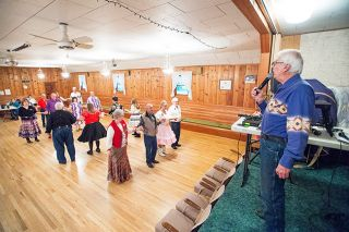 Marcus Larson/News-Register##Square dance caller Leonard Snodgrass calls out each move during the Braids & Braves dance. Snodgrass said he has to plan the calls so couples end up together.