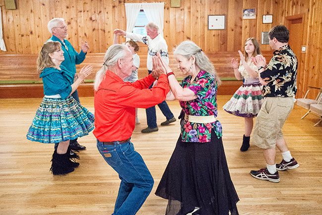Marcus Larson/News-Register##Square dancers Mike Yoder and Nadya King meet while performing a dance move at the Braids & Braves final get-together in the McMinnville Grange. The club will move to Dayton in September.
