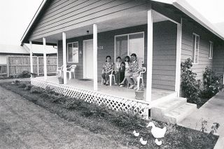News-Register file photo##In December 1993, members of the Sanchez family relax on their very own porch: Trinidad, Lupita, Ana, Imelda and Rafael. They moved into McMinnville's first Habitat house almost three years earlier.