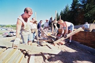News-Register file photo##In 1998, Oregon Mutual Insurance Co. employees work on a Habitat for Humanity house on Adams Street in Lafayette.  From left are Jason Youngblutt, Eric Watt, Mike Heidinger and Kim Kinion.