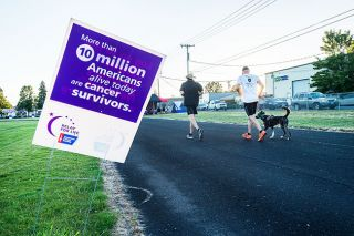 Marcus Larson / News-Register##Participants in the annual Relay for Life event round the track at Baker Field continuously from Friday afternoon until noon Saturday.