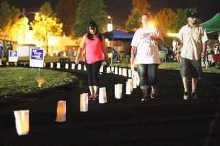 Rockne Roll/News-Register##Relay for Life participants circle the track at the McMinnville School District's property at Baker and 17th Street during the American Cancer Society's annual fundraiser Saturday, June 27.
