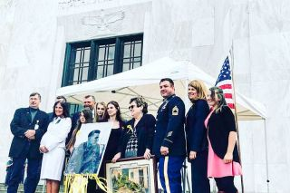 Submitted photo##Speakers and Senate Bill 1054 advocates, including State Sen. Brian Boquist, left, take pictures with  family members of Will Naugle, an Afghanistan veteran who committed suicide, during an early June rally at the state capitol.