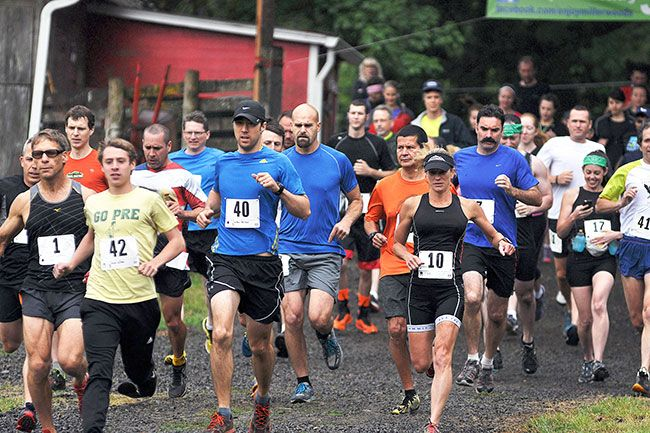 Robert Husseman/News-RegisterRunners break from the starting line at the Miller Woods Trail Race on Saturday.