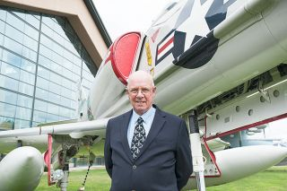 Marcus Larson/News-Register file photo##Larry Wood, director of the Evergreen museums, with his favorite plane — the Douglas A-4E Skyhawk. The Marine colonel flew 295 missions in Vietnam, most of them in the light, speedy A-4.