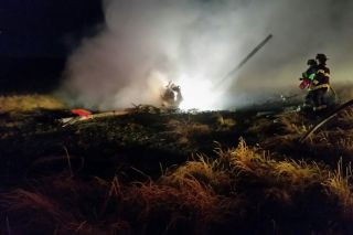 Courtesy Newberg Fire Department##Newberg firemen extinguish a field fire caused by a helicopter crash late Wednesday night in Newberg.