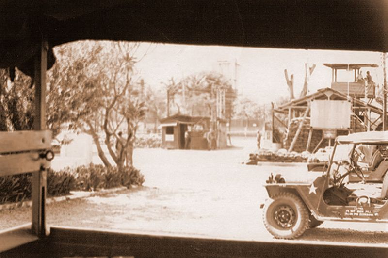 Submitted photo##The guard shack/entrance bunker for Muscara Compound, South Vietnam, (center), as viewed from the back of a truck, was a frequent target for the Viet Cong. Tan Son Nhut Air Base is a few miles away.