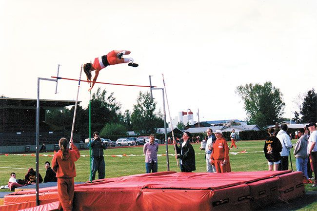 Courtesy of Karina TaylorKarina Elstrom (vaulting) holds the McMinnville High School record in the pole vault at 11 feet, 6 inches. She was the 1996 Class 4A state champion in the event, helping the Grizzlies win their first girls track and field state championship in school history.