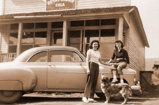 Baker County LibraryPostmistress and Robinette Store owner Francis Carrithers with daughter, Diane, and their dog, Tojo, at the family store in the early 1950s.