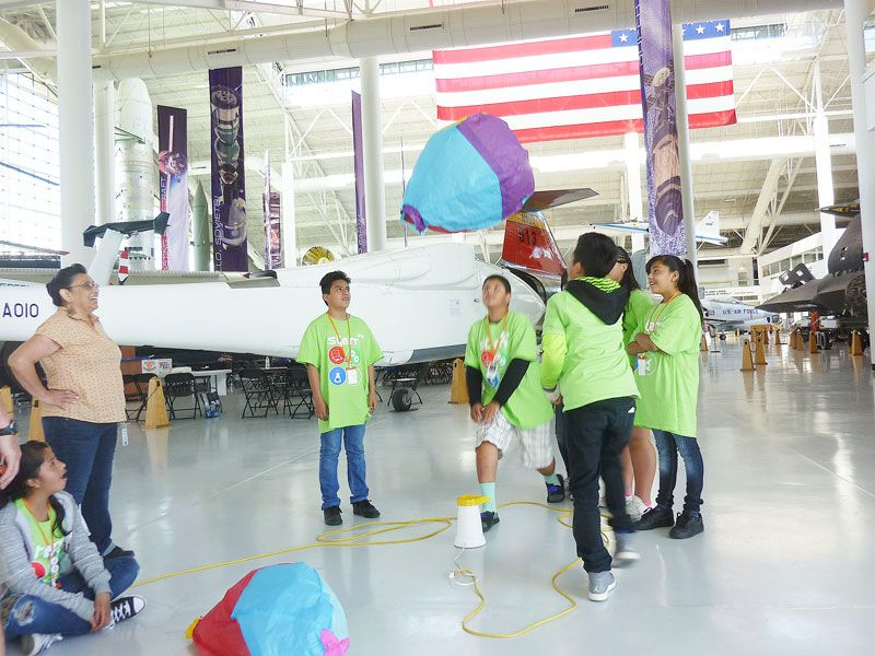 Starla Pointer / News-Register##Students in the STEM camp celebrate as warm air causes their balloon to rise into the air in the Evergreen Space Museum.