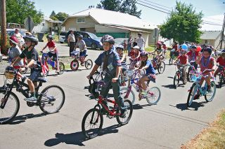 Tom Henderson/News-Register##Children of Lafayette ride their bikes during the city's Fourth of July parade Saturday. It started at Joel Perkins Park and winded its way through town.