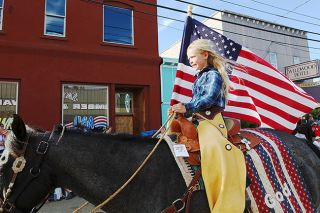 Rockne Roll/News-Register##Kennedy Laughlin rides down Main St. in Willamina during Saturday's Fourth of July Parade. The city