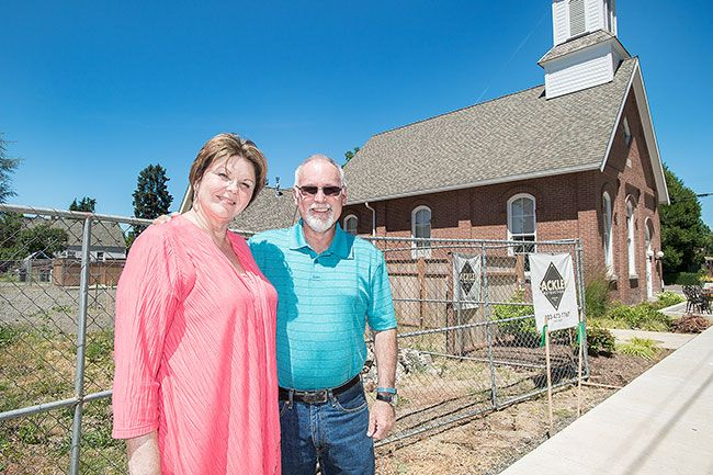 Marcus Larson/News-Register##Debbie and Cal Kearns, in front of the lot where the new Dayton Mercantile will be built, next to the Block House Cafe and across from city park. Debbie and two friends are opening the shop.