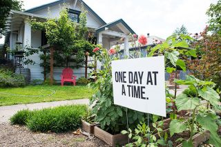 Rusty Rae/News-Register##A sign on McMinnville s 8th Street urges people to take  One Day at a Time.