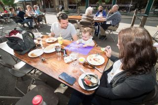 Marcus Larson/News-Register##Eric and Laura McGlynn and their son Wesley ate at La Rambla during McMinnville s first Dine Out(side) event on Third Street on July 3.