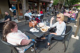 News-Register file photo##During the first summer Dine Out(side) in downtown McMinnville, Sheri Lunsford, left, and Susan MacLean enjoy lunch at McMenamins. About 30 restaurants will set up tables on Third Street this summer during the second round of Dine Out(side).