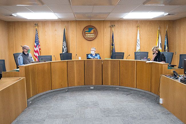 Marcus Larson/News-Register##Yamhill County Commissioners use masks during Thursday s hearing.