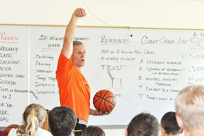 Robert Husseman/News-RegisterLarry Doty instructs campers on proper jumpshot follow-through during a classroom session.
