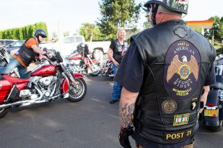 Rockne Roll/News-Register##Jerry Perry, right, and other American Legion Riders prepare for a group ride to Dayton at American Legion Post 21 in McMinnville. They went to support Rider Jim Connolly, who was playing with Second Winds in the Dayton park.