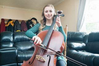 Marcus Larson/News-Register##Olivia Cheser has always loved music, especially singing and playing her cello. Next year, she will play in an orchestra at Oregon State University, where she will major in music production.