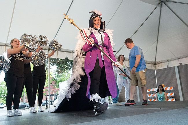 Marcus Larson / News-Register##Carrie Schadewitz is crowned McMinnville s Biggest Turkey for 2016. She will reign over the festival, which continues Saturday. Schadewitz raised the most money for her charity, Willamette Valley Cancer Foundation.