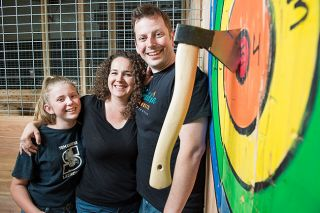 "Rusty Rae/News-Register##Emmy, Leah and Cody Wilson think they'll score a bull's eye with their new business, West Coast Axe, located on First Street in McMinnville. Throwing axes offers ""stress-relief, competition and, most of all, fun,"" Leah says."