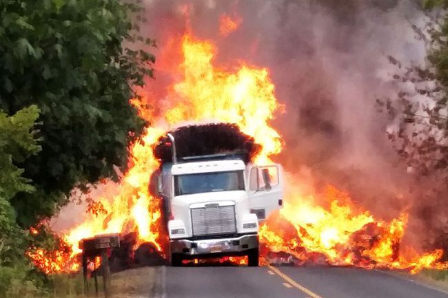 Photo by Carrie Conrad Switala##A hay truck caught fire Monday night west of McMinnville on Hill Road near Peavine Road,.
