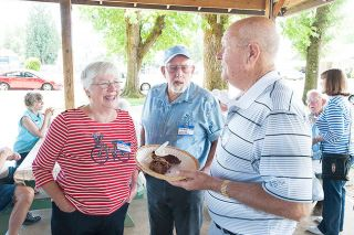 Marcus Larson/News-RegisterBonnie and Norman Clow chat with Jim McFarlane about their childhood days during a reunion for those who attended local country schools.