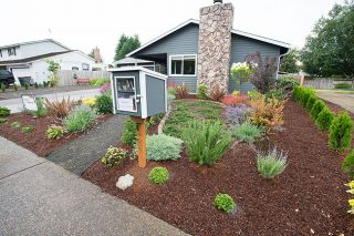 Marcus Larson/News-Register##A little library invites locals to grab a book while admiring the yard of Brian and Jenifer Rucker, who designed the garden to be drought tolerant.
