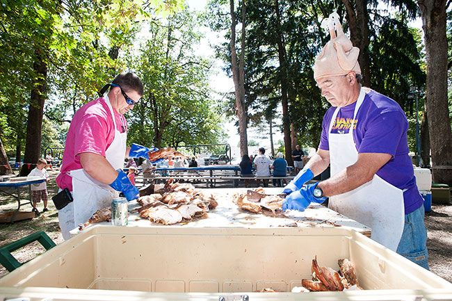 News-Register file photo##Volunteers barbecue turkey in Wortman Park at a previous Turkey Rama celebration.