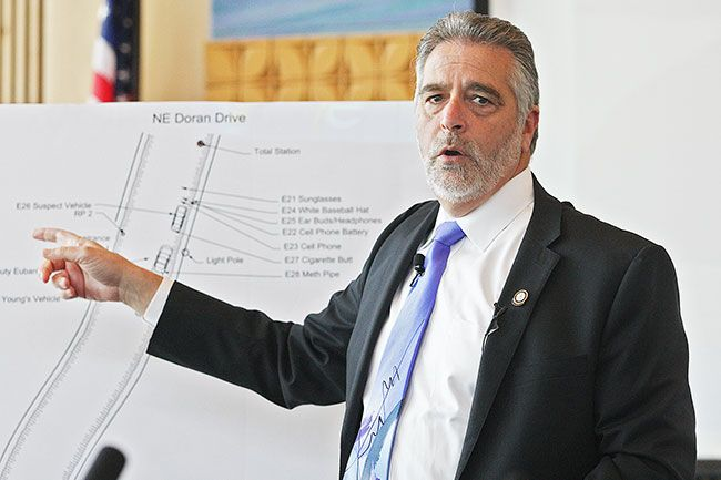 Rockne Roll/News-Register##District Attorney Brad Berry describes a diagram of the July 1 officer-involved shooting during a press conference Thursday afternoon at the McMinnville Civic Center.