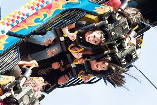 Marcus Larson/News-Register file photo##Kyann Boyce and Britney Billarreal scream with excitement going upside-down on a carnival ride during last year's Turkey Rama. The carnival returns this year to OMI's parking lot.