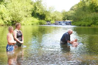 Rockne Roll / News-Register##Pastor Kevin Cope baptises Quintin McAvoy, 10, in the North Yamhill River Sunday. It was Carlton First Baptist Church s first river baptism in decades.