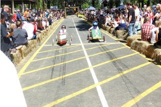 News-Register file photoSteep competition: Derby car races draw crowds to the ramp in Beulah Park.