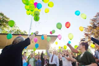 Rockne Roll/News-Register##Participants release balloons into the evening sky at a gathering last Thursday at the Yamhill County Courthouse to remember the victims of the May 2016 street racing crash on Highway 99W north of McMinnville.