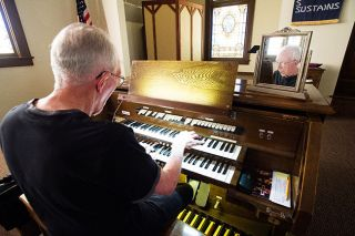 "Marcus Larson/News-Register##David Howard plays a hymn at First Presbyterian Church in McMinnville. He's retiring this month after 28 years as the church's organist. ""My playing is worship,"" he says."